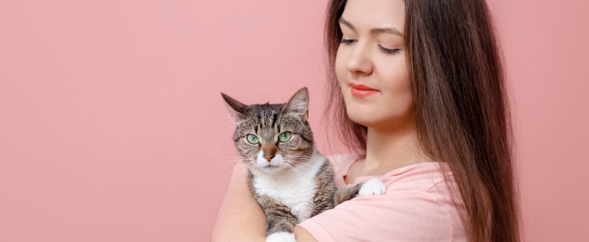 Young Women Holding a Cat